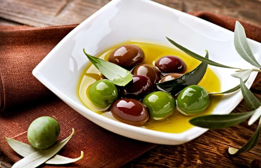 olives and olive oil in bowl