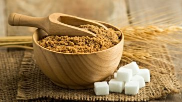 palm sugar in wooden bowl with scoop