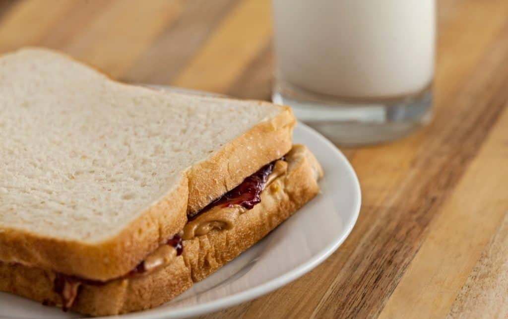peanut butter and jelly sandwich and glass of milk