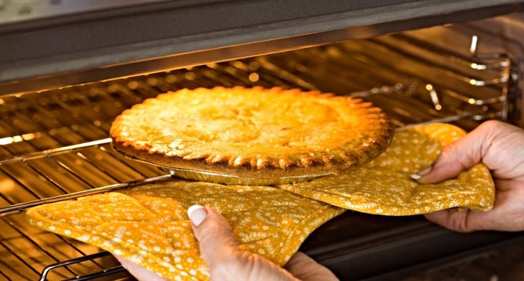 pie being pulled out of the oven