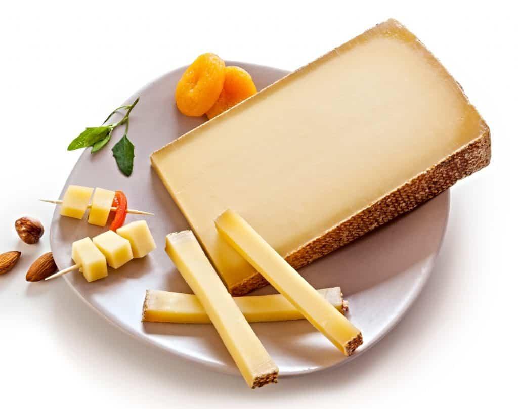 slice of Gruyere cheese on plate