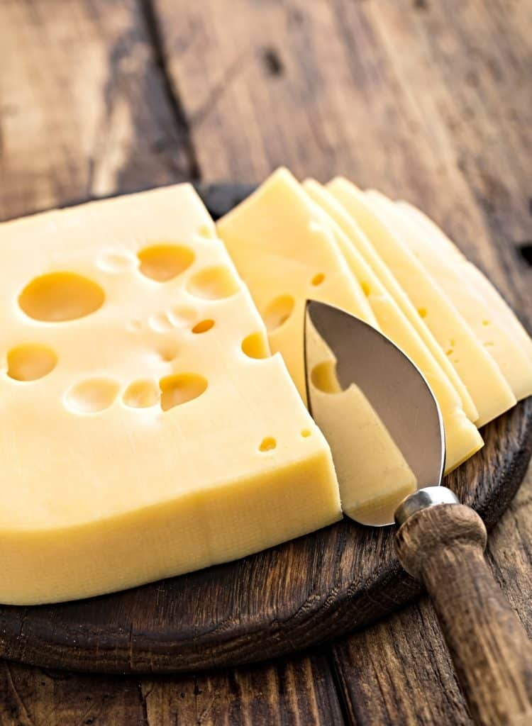 sliced swiss cheese and cheese knife
