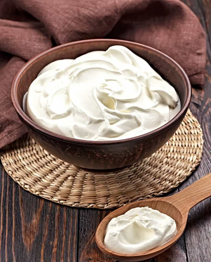 sour cream in bowl and spoon
