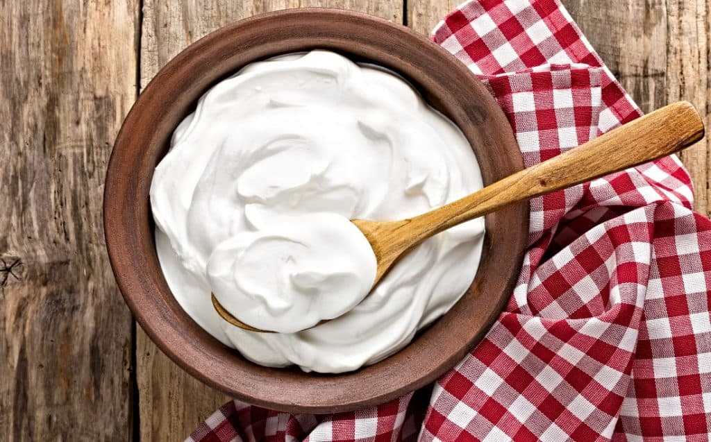 sour cream in bowl with spoon