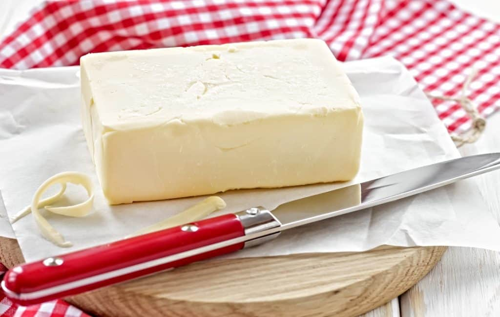 stick of butter with butter knife