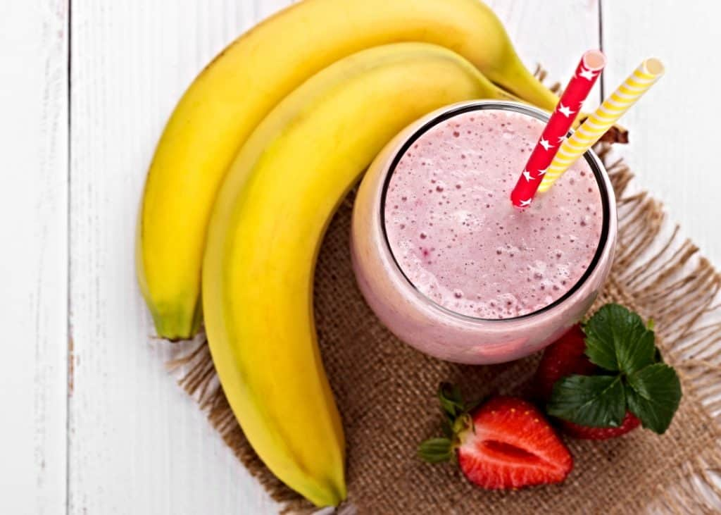strawberries and bananas and a smoothie
