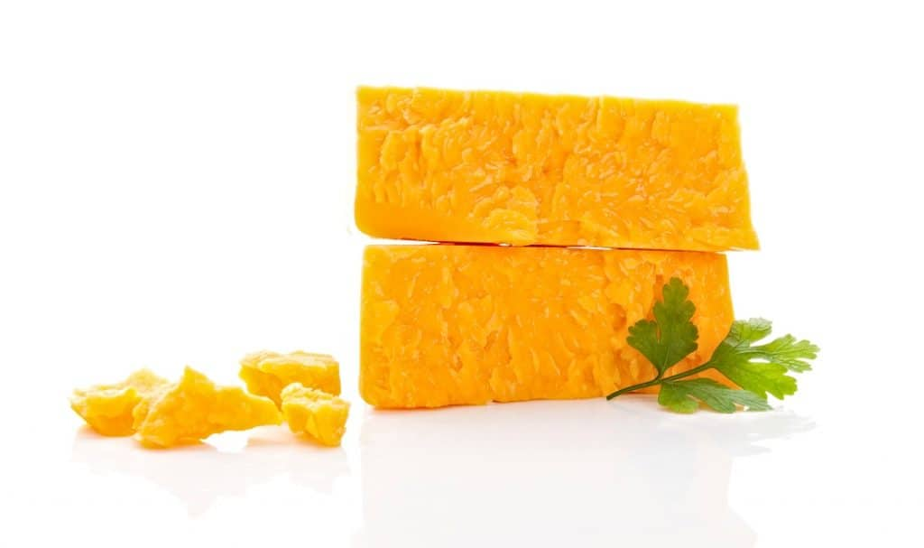 two chunks of cheddar cheese