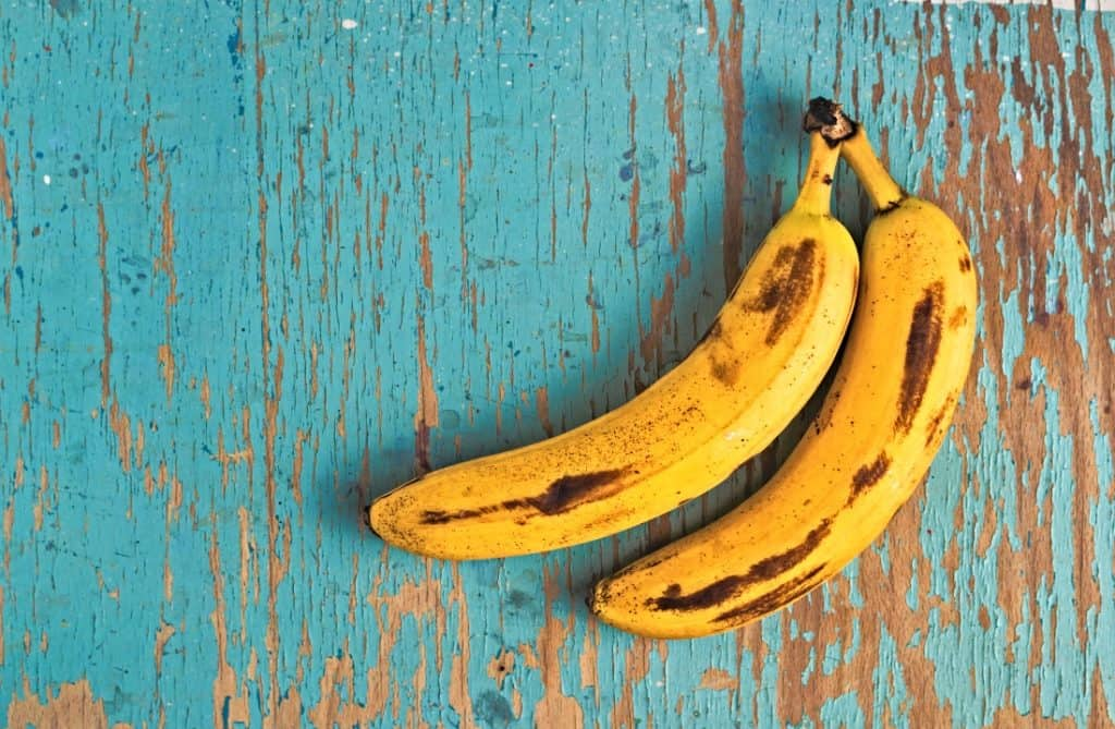 two ripe bananas on table