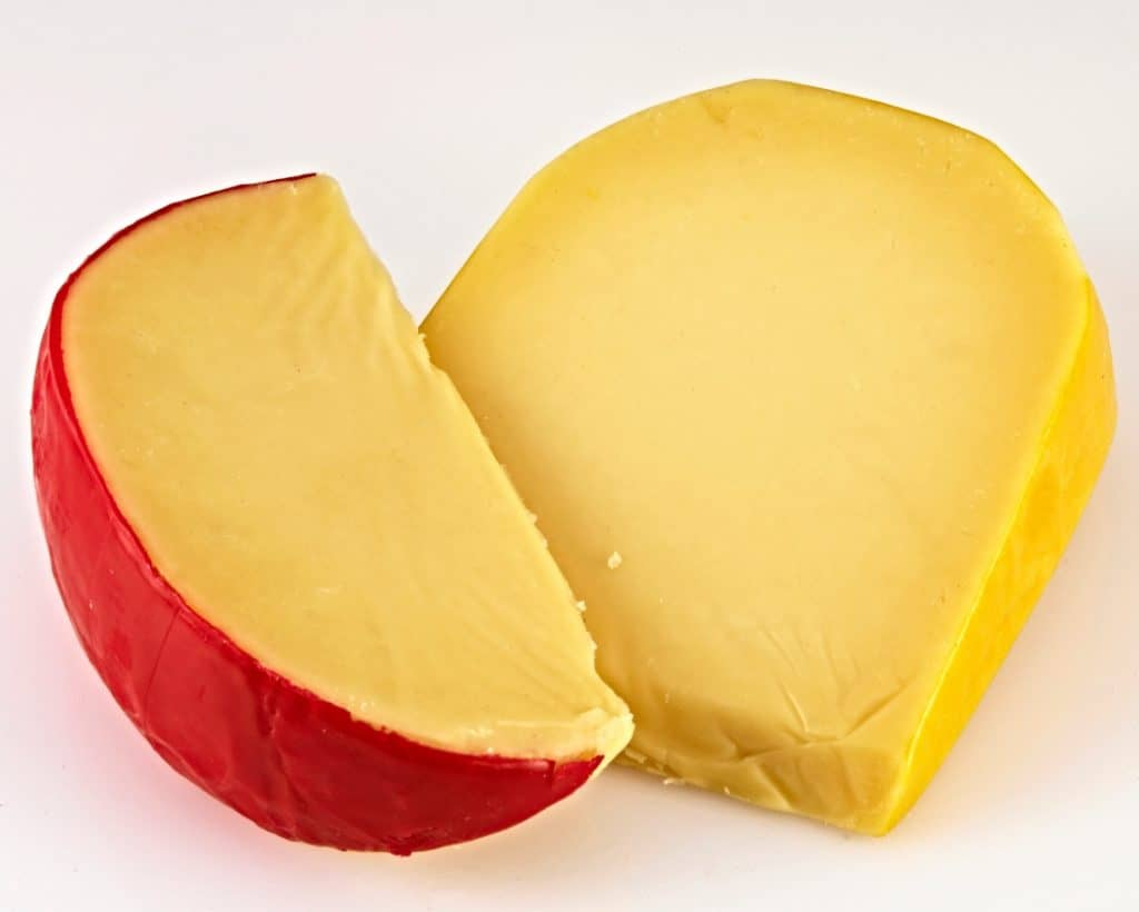 wedge of tislit and gouda cheese