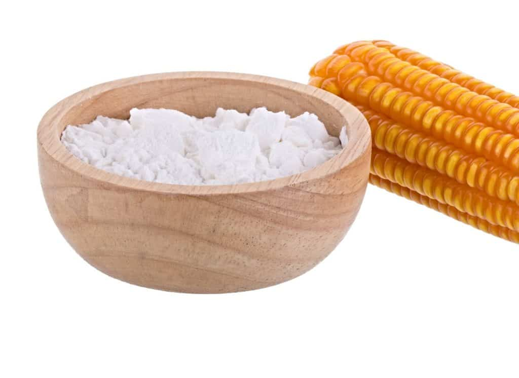 wooden bowl of cornstarch and ear of corn