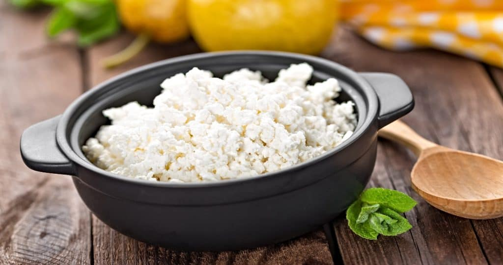 cottage cheese and wooden spoon