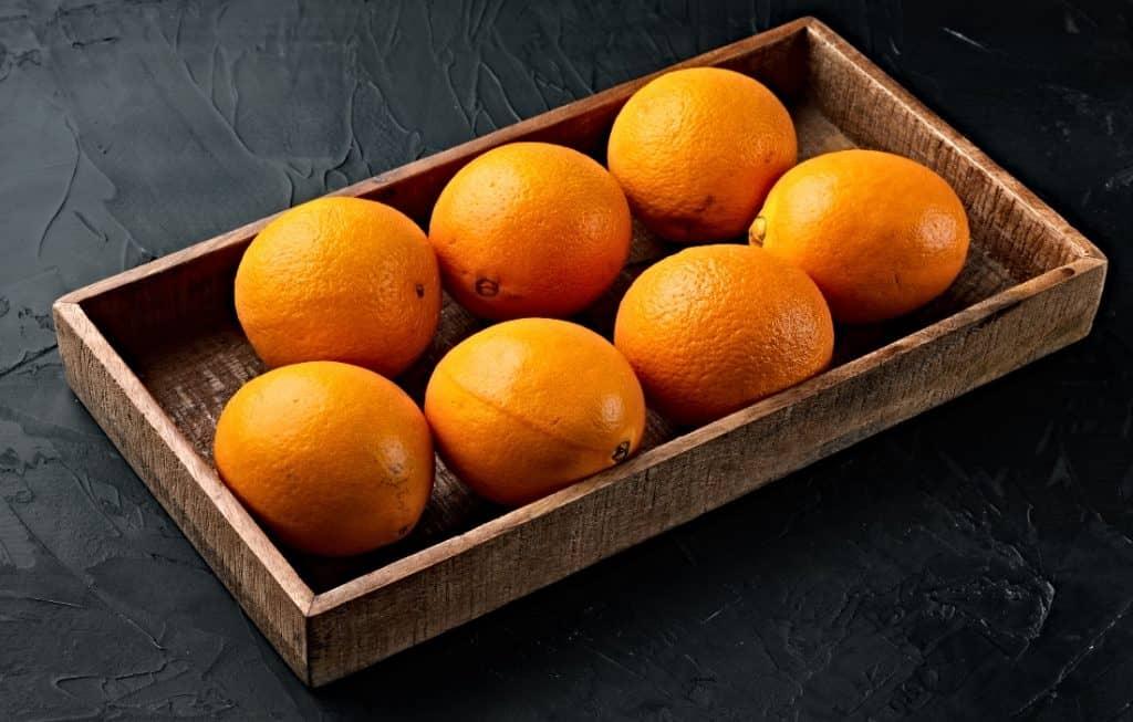 navel oranges in wood crate