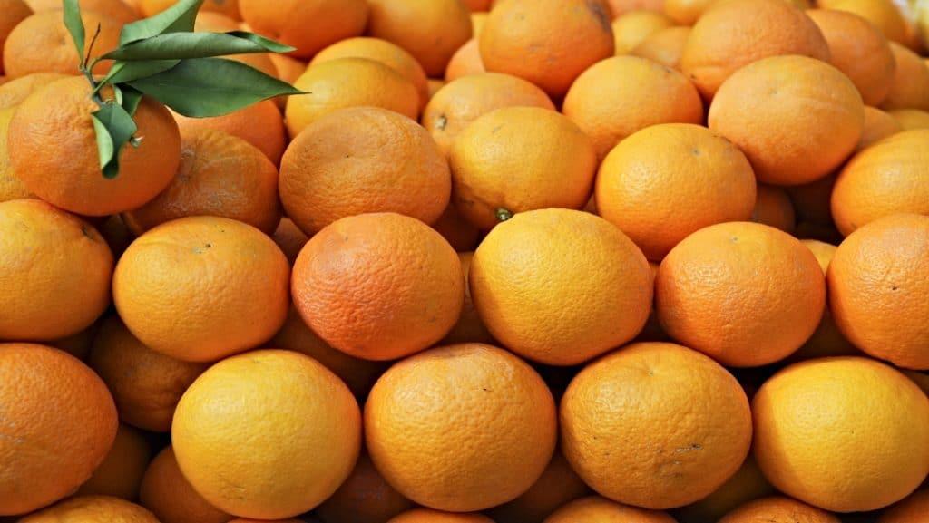numerous fresh Valencia oranges